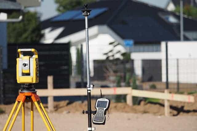 Surveyor measuring land for subdivision